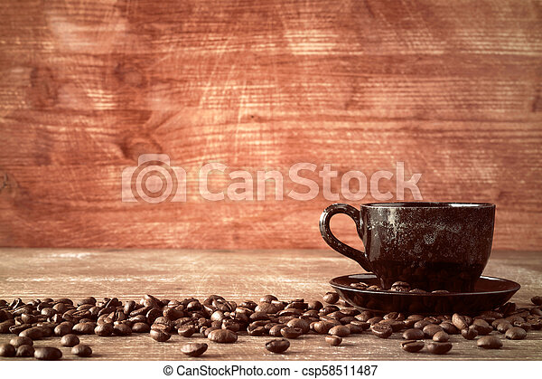 Coffee cup and coffee beans - csp58511487
