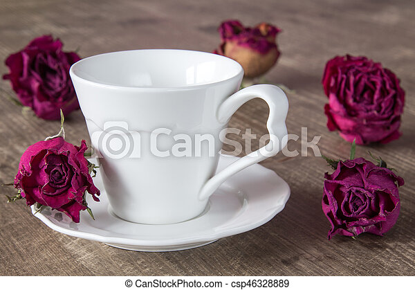 Coffee cup and dry buds of roses - csp46328889