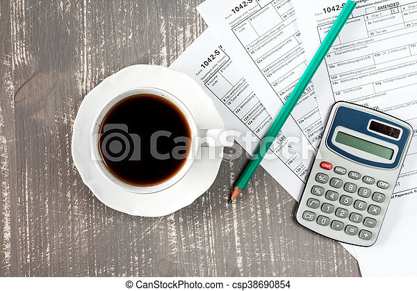 Coffee cup and tax forms - csp38690854
