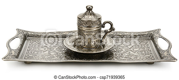 Coffee cup and tray with arabic decoration isolated on a white background. Wide photo. - csp71939365