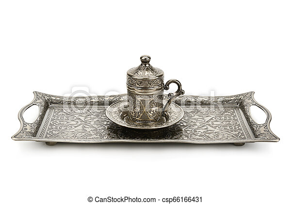 Coffee cup and tray with arabic decoration with metal cup and dish isolated on a white background. - csp66166431
