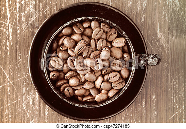 Coffee cup full of coffee beans. - csp47274185