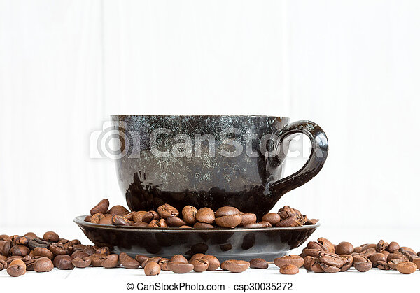Coffee cup on a white background with coffee beans - csp30035272