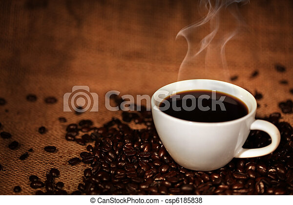 Coffee cup on roasted coffee beans - csp6185838