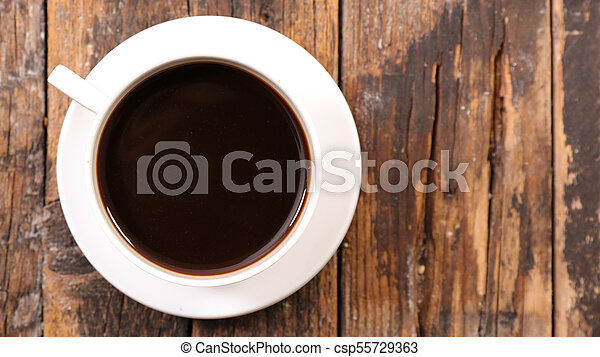 coffee cup on wood background - csp55729363