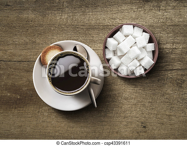 Coffee cup top view with sucre cup on dark wooden table - csp43391611