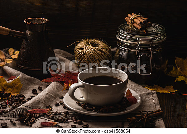 Coffee Cup with Autumn Leaves - csp41588054