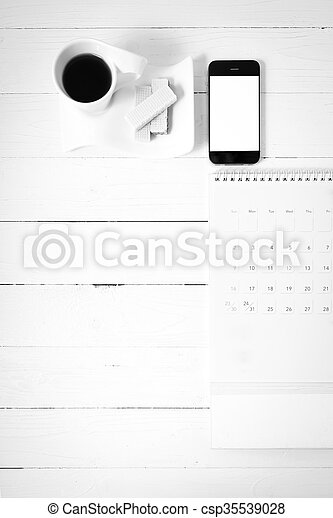 coffee cup with wafer, phone, calendar black and white color - csp35539028