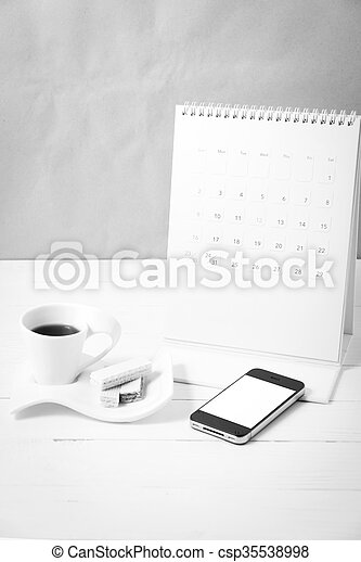 coffee cup with wafer, phone, calendar black and white color - csp35538998