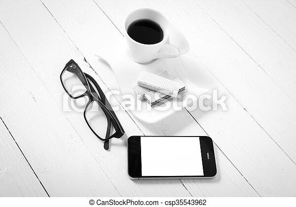 coffee cup with wafer, phone, eyeglasses black and white color - csp35543962