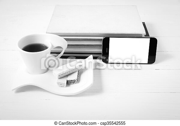 coffee cup with wafer, phone, stack of book black and white color - csp35542555