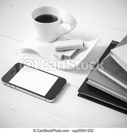 coffee cup with wafer, phone, stack of book black and white color - csp35401232