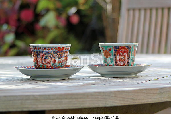 Coffee Cups Beautiful Coffee Cups In Sauces On A Wooden Garden Table In A Country Garden Canstock