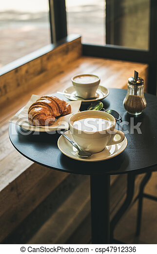 Coffee Latte, Cappuccino And Croissant On Small Table In Cafe   Csp47912336
