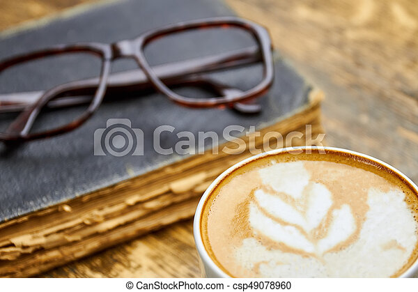 Coffee, old book and glasses. - csp49078960