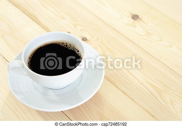 Coffee on wood table - csp72485192