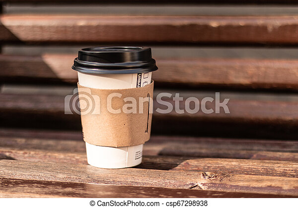 Astonishing Coffee To Go Cup Behind On A Wooden Bench Pdpeps Interior Chair Design Pdpepsorg