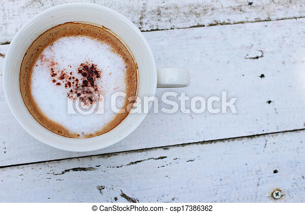 coffee with a white cup on wooden - csp17386362
