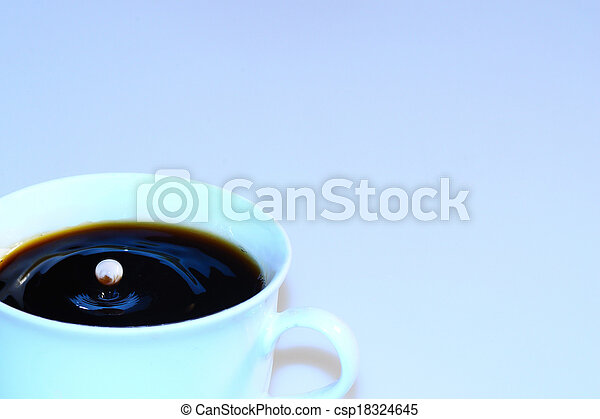 coffee with bouncing milk drops - csp18324645