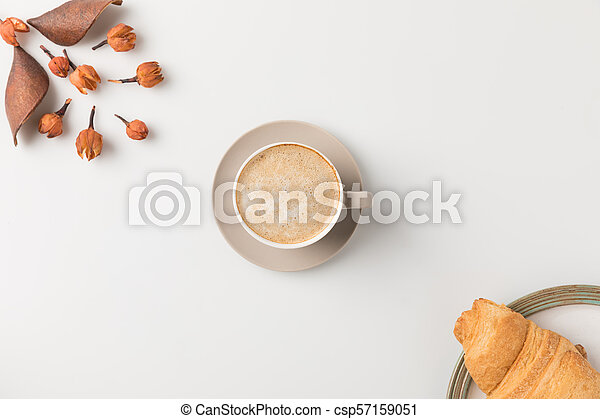 coffee with flowers and croisssant - csp57159051