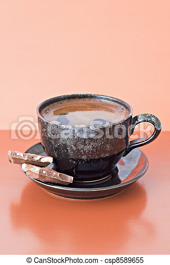 coffee with two chocolate pieces - csp8589655