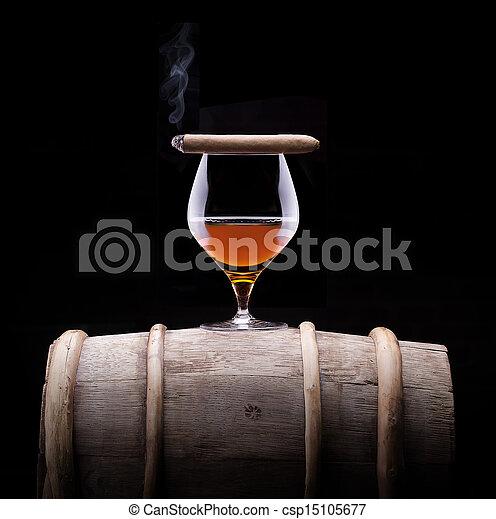 Cognac and Cigar on black with vintage barrel - csp15105677