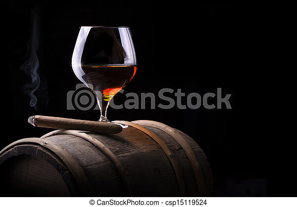 Cognac and Cigar on black with vintage barrel - csp15119524