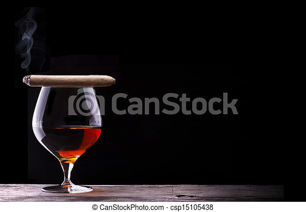 Cognac and Cigar on black with vintage table - csp15105438