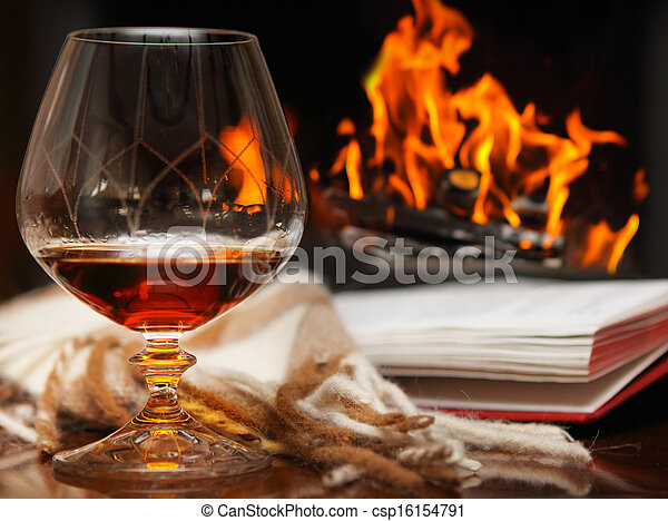Cognac by the fireplace - csp16154791
