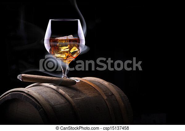 Cognac glass shrouded in a smoke - csp15137458