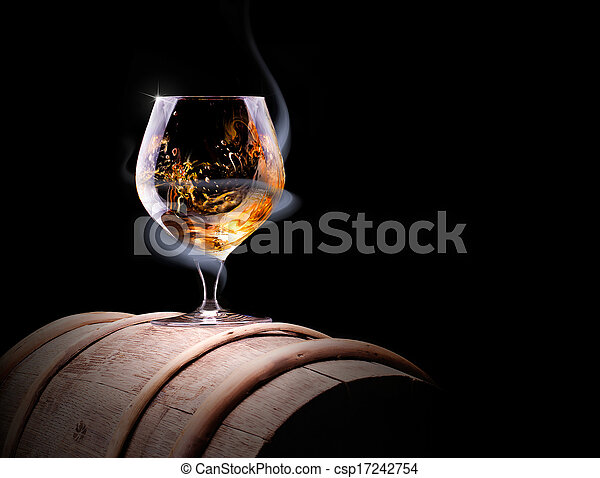 Cognac glass shrouded in a smoke - csp17242754