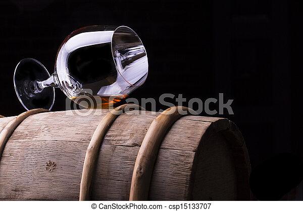 Cognac or brandy on a wooden barrel - csp15133707
