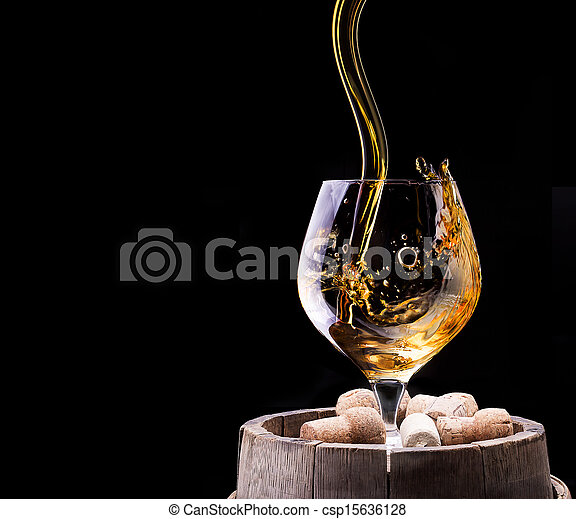 Cognac or brandy on a wooden table - csp15636128
