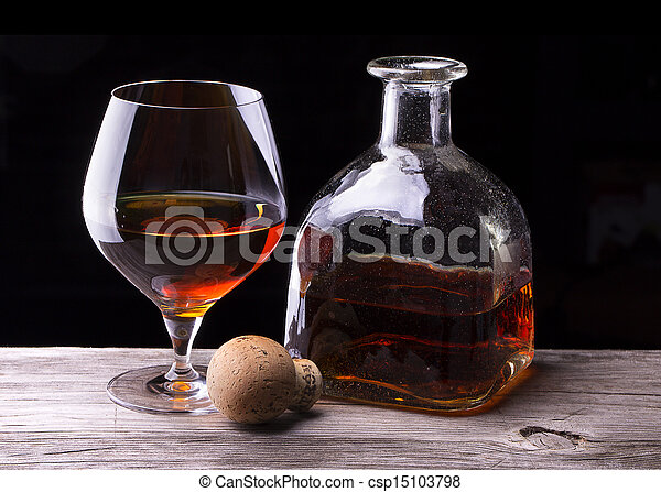 Cognac or brandy on a wooden table - csp15103798