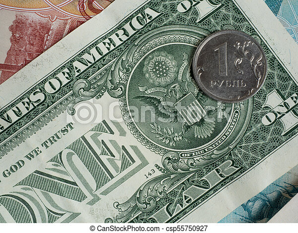 Coin one ruble on the background of the US dollar - csp55750927