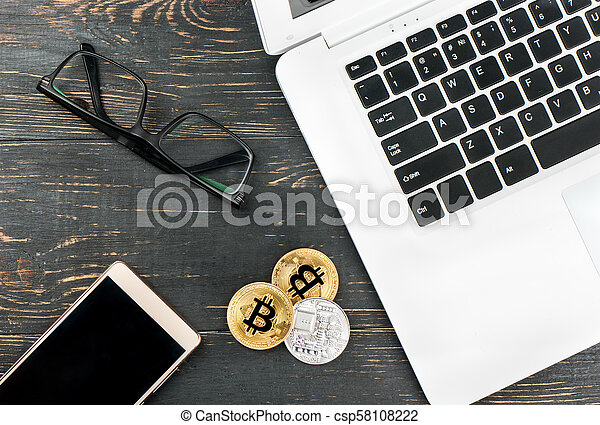 Coins bitcoin with laptop - csp58108222