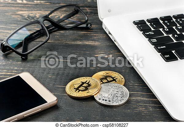 Coins bitcoin with laptop - csp58108227