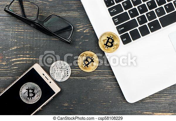 Coins bitcoin with laptop - csp58108229