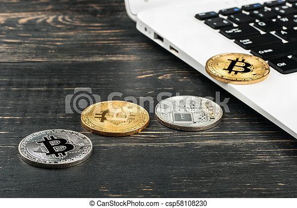 Coins bitcoin with laptop - csp58108230