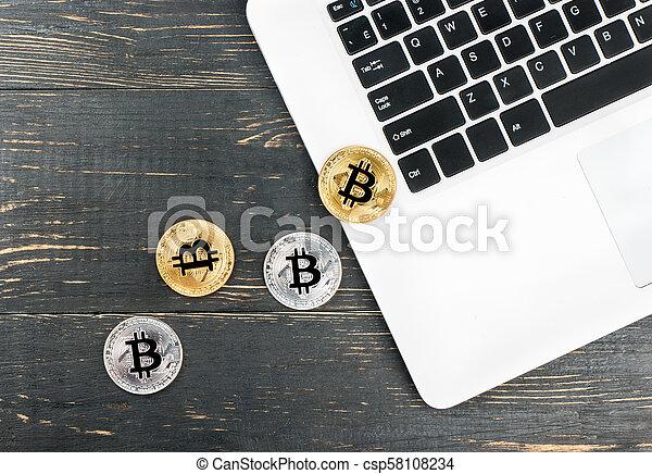 Coins bitcoin with laptop - csp58108234