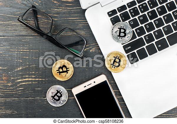 Coins bitcoin with laptop - csp58108236