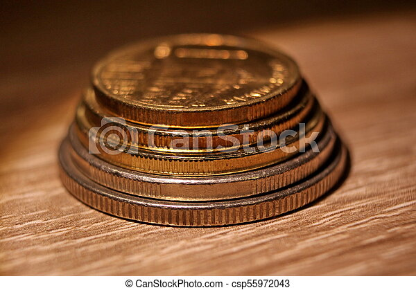Coins on the table - csp55972043