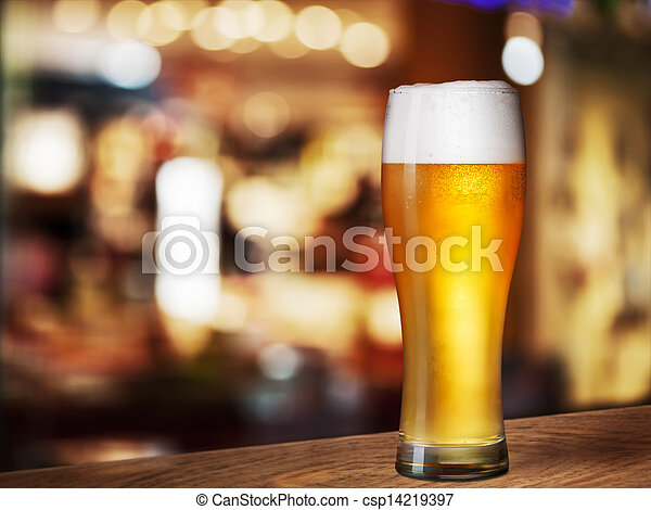 cold beer glass on bar or pub desk - csp14219397