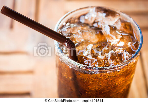 Cold glass with cola and ice cubes - csp14101514