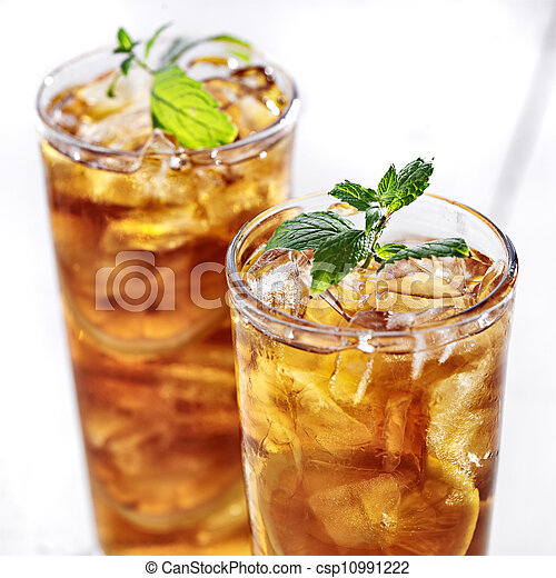 cold iced tea with mint garnish and sliced lemons - csp10991222