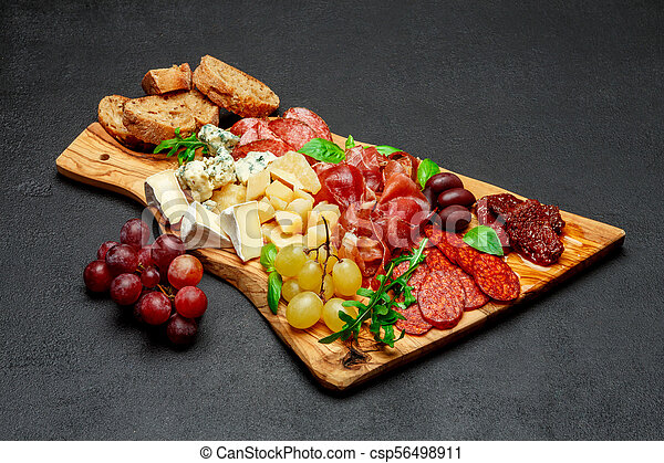 Cold meat cheese plate with salami sausage prosciutto and cheese - csp56498911 & Cold meat cheese plate with salami sausage prosciutto and cheese ...