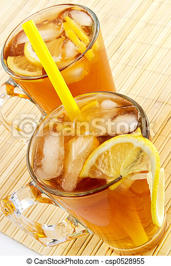 Cold tea with cubes of an ice and a lemon - csp0528955