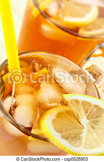 Cold tea with cubes of an ice and a lemon - csp0528953