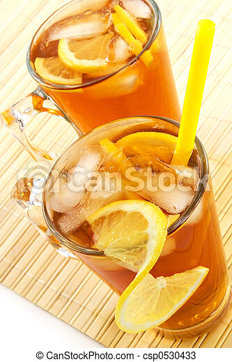 Cold tea with cubes of an ice and a lemon - csp0530433