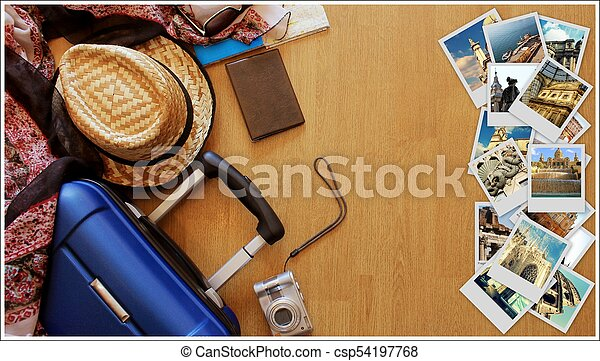 Collage of European landmarks, set of Travel Images. Suitcase and tourist stuff on wooden background - csp54197768